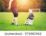 Little Boy Playting Football...