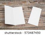 bifold white template paper on... | Shutterstock . vector #573487450