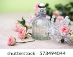 Perfume Bottle And Roses. Retr...