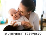 beautiful mother holding her... | Shutterstock . vector #573498610