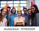 happy coworkers celebrating a... | Shutterstock . vector #573502039