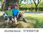 two joyful little football... | Shutterstock . vector #573504718