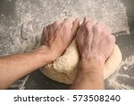 male hands kneading dough on... | Shutterstock . vector #573508240