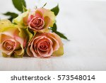 Pink Roses On A Wooden...