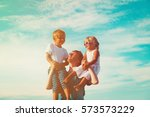 happy father with two kids on... | Shutterstock . vector #573573229