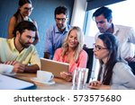 group of coworkers watching a... | Shutterstock . vector #573575680