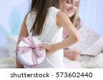 cute little girl hiding present ... | Shutterstock . vector #573602440