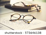 vintage glasses  notebook and... | Shutterstock . vector #573646138