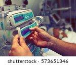 medical worker configures... | Shutterstock . vector #573651346