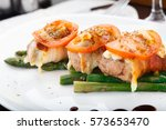 bacon wrapped chicken breast | Shutterstock . vector #573653470