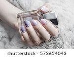 Woman With Manicure Holds A...