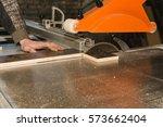 men at work sawing wood....   Shutterstock . vector #573662404