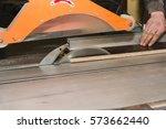 men at work sawing wood....   Shutterstock . vector #573662440