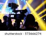 tv camera in event hall. | Shutterstock . vector #573666274