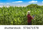 farmer using digital tablet... | Shutterstock . vector #573671578