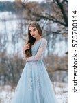 lady in a luxury lush blue... | Shutterstock . vector #573700114