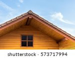 attic outside of wooden house... | Shutterstock . vector #573717994