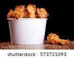 bbq chicken wings in a white... | Shutterstock . vector #573721093