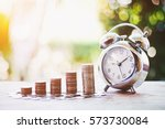 close up of time and money with ... | Shutterstock . vector #573730084
