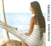 happy girl lying in a hammock... | Shutterstock . vector #573748984