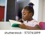 school girl reading book in... | Shutterstock . vector #573761899