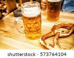 oktoberfest beer and pretzel on ...   Shutterstock . vector #573764104