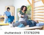 rehab clinic gym. elderly man...   Shutterstock . vector #573782098