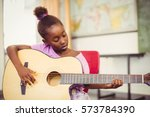 Schoolgirl Playing Guitar In...