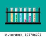 test glass tubes in rack.... | Shutterstock .eps vector #573786373