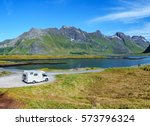 caravan car travels on the... | Shutterstock . vector #573796324