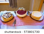 cheesecake at a wedding... | Shutterstock . vector #573801730