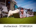 woman on the grass with a dog... | Shutterstock . vector #573801814