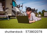 woman on the grass  looking at... | Shutterstock . vector #573802078