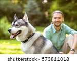 Man And Husky Dog Walk In The...