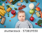 baby surrounded with fruits and ... | Shutterstock . vector #573819550