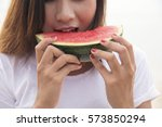 young woman eating watermelon.... | Shutterstock . vector #573850294