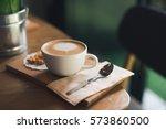 coffee latte art in coffee shop | Shutterstock . vector #573860500