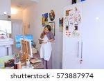 lovely female painter orders... | Shutterstock . vector #573887974