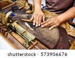 Closeup Of Hands Making Cigar...