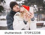 happy couple taking selfie by... | Shutterstock . vector #573912238