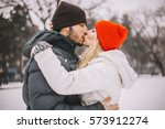cheerful young couple walking... | Shutterstock . vector #573912274