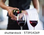 mid section of waitress pouring ... | Shutterstock . vector #573914269