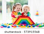 child playing with colorful... | Shutterstock . vector #573915568
