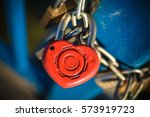 A Rusty Red Love Lock With A...