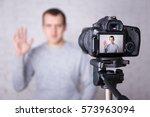 happy video blogger on screen... | Shutterstock . vector #573963094