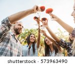 group young friends toast with... | Shutterstock . vector #573963490