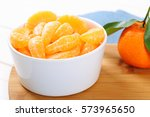 whole ripe tangerine with... | Shutterstock . vector #573965650