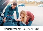 couple on the road having... | Shutterstock . vector #573971230