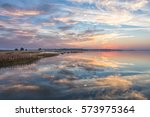 beautiful sunrise over river... | Shutterstock . vector #573975364