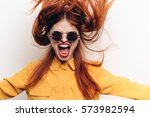 crazy woman screaming bright... | Shutterstock . vector #573982594